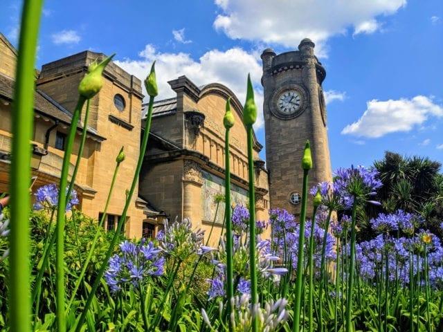 https://whereandwhenlondon.com/wp-content/uploads/2020/07/Horniman-museum-clocktower-with-agapanthus-640x480.jpg